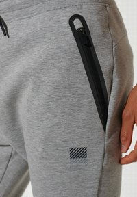 Superdry - TRAINING GYMTECH - Tracksuit bottoms - grey marl - 1