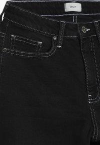 Grunt - ELLIE WIDE LEG CROPED - Flared Jeans - clam black - 4