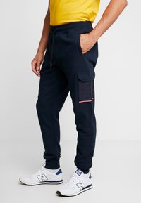 Tommy Hilfiger - MIXED MEDIA - Tracksuit bottoms - blue - 0