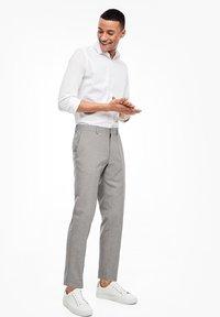 s.Oliver BLACK LABEL - Suit trousers - brown melange - 4