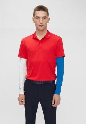 LEON  - T-shirt de sport - red bell