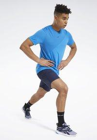 Reebok - UTILITY ESSENTIALS TRAINING 1/2 - Pantaloncini sportivi - blue - 1