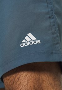 adidas Performance - OWN THE RUN RESPONSE RUNNING  - Pantalón corto de deporte - legblu - 3