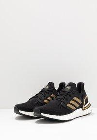 adidas Performance - ULTRABOOST 20 PRIMEKNIT RUNNING SHOES - Neutral running shoes - core black/gold metallic/solar red - 2