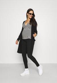 MAMALICIOUS - MLFARGO - Jeans Skinny Fit - black - 1