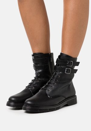 COMBAT BOOT - Lace-up ankle boots - black