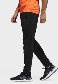 adidas Performance - OWN THE RUN ASTRO JOGGERS - Tracksuit bottoms - black - 2