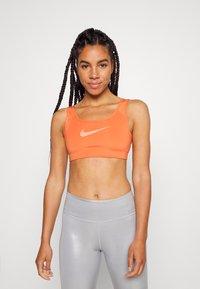 Nike Performance - BRA - Medium support sports bra - light sienna/healing orange - 0