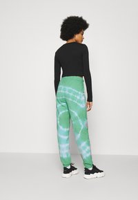 NEW girl ORDER - TRIBAL DRAGON TIE DYE JOGGERS - Tracksuit bottoms - green - 2