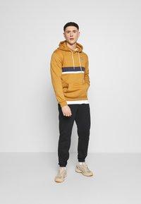 adidas Originals - LOGO - Pantalon de survêtement - black - 1