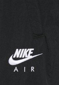 Nike Sportswear - AIR PANT - Tracksuit bottoms - black/white - 6