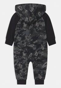 Nike Sportswear - CRAYON CAMO - Overall / Jumpsuit - black - 1