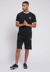 Hummel - JIMMY - Print T-shirt - black - 1