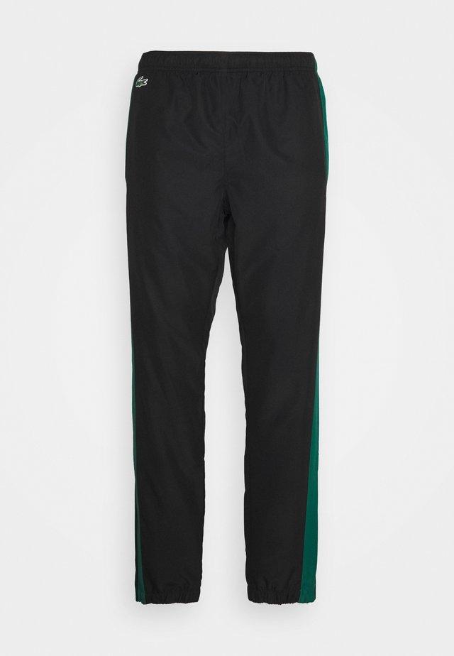 TENNIS PANT - Pantalon de survêtement - black/bottle green