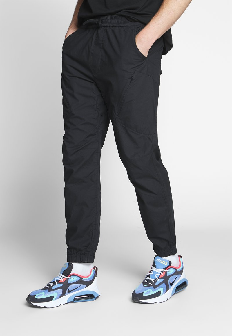 Carhartt WIP - COLTER PANT - Trousers - black/white