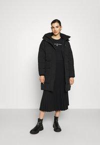Calvin Klein Jeans - ROUND TEE - Print T-shirt - black - 1