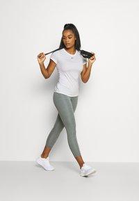 Nike Performance - ONE SLIM - T-shirt basic - white/black - 1