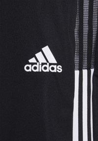 adidas Performance - TIRO 21 - Tracksuit bottoms - black/white - 5