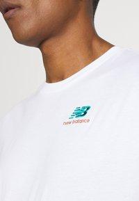 New Balance - ESSENTIALS EMBROIDERED TEE - Basic T-shirt - white - 5