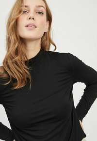 Vila - VIBULIS ZEBRA FUNNELNECK - Long sleeved top - black - 3