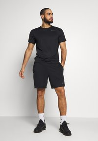 Nike Performance - Basic T-shirt - black/white - 1