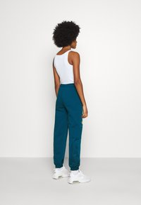 Nike Sportswear - PANT - Tracksuit bottoms - valerian blue/deep ocean/metallic gold - 2
