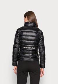 Calvin Klein Jeans - BACK LOGO ELASTIC MOTO JACKET - Winter jacket - black - 2