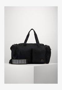 Nike Performance - UTILITY POWER DUFF - Sportovní taška - black/enigma stone - 5