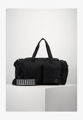 UTILITY POWER DUFF - Sports bag - black/enigma stone
