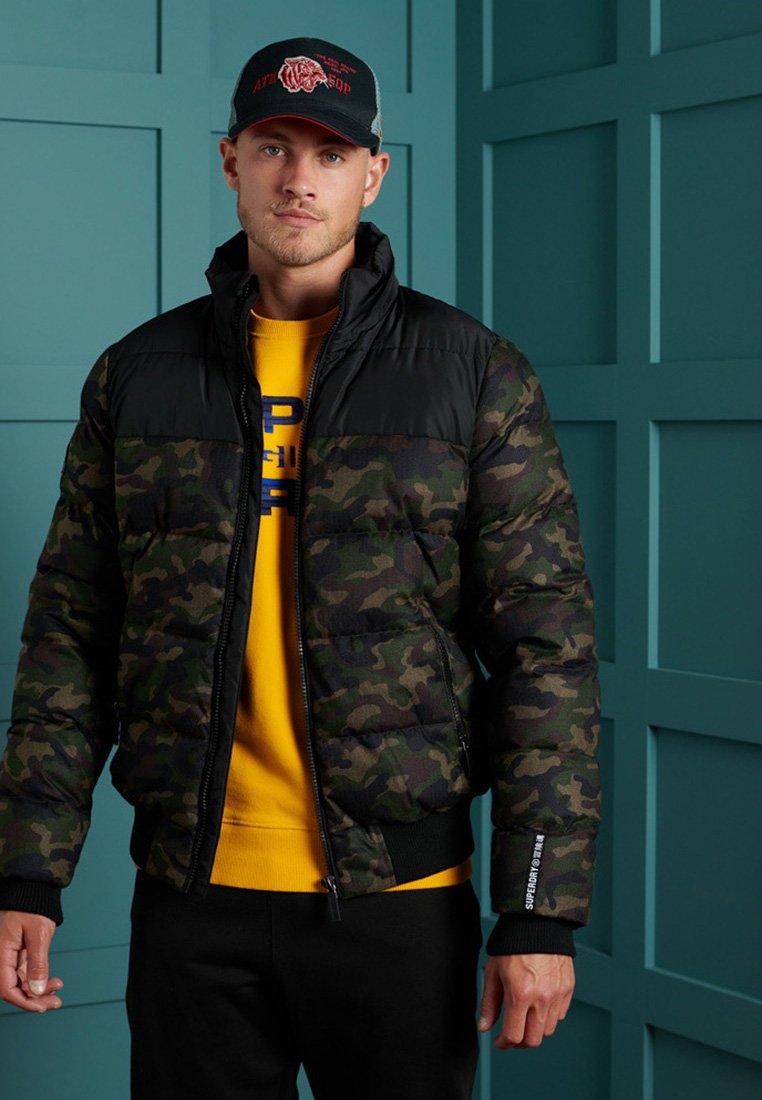 Superdry - TRACK SPORT PUFFER - Winter jacket - camo/black