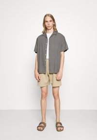 BDG Urban Outfitters - JOGGER UNISEX - Shorts - mustard - 1