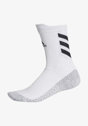 ALPHASKIN TRAXION - Calcetines de deporte - white