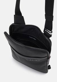 Calvin Klein - FLATPACK - Across body bag - black - 2