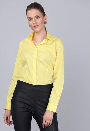 Skjorta - yellow