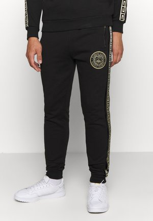 RODELL JOGGER - Pantalon de survêtement - black/gold