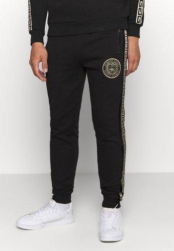 RODELL JOGGER - Pantaloni sportivi - black/gold