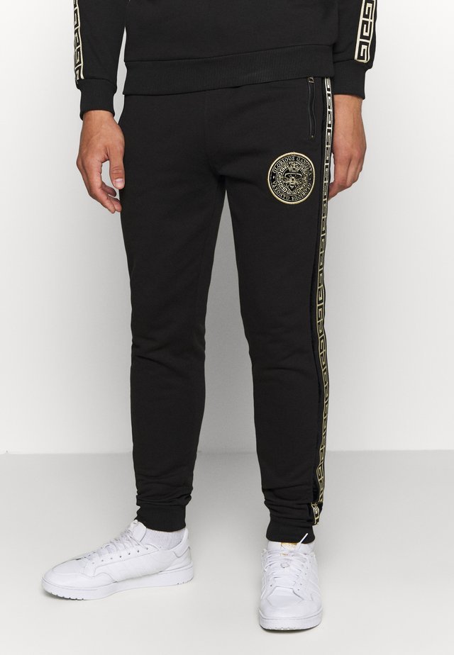 RODELL JOGGER - Tracksuit bottoms - black/gold