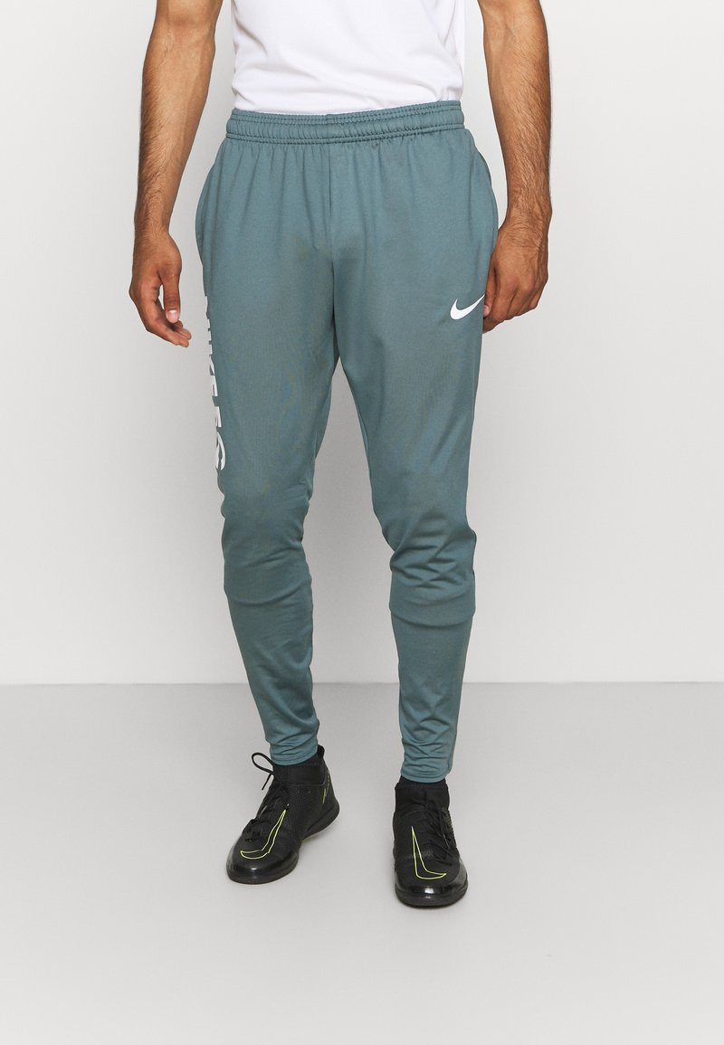 Nike Performance - FC PANT - Teplákové kalhoty - hasta/white