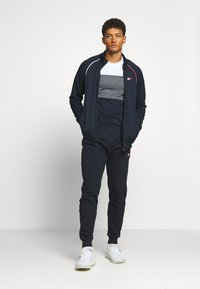 Tommy Hilfiger - PIPING CUFFED PANT - Tracksuit bottoms - blue - 1