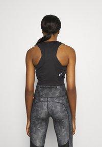 Nike Performance - RACE CROP - Topper - black - 2