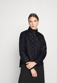 Selected Femme - SLFPLASTICCHANGE QUILTED JACKET - Light jacket - black - 0
