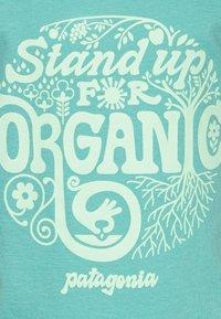 Patagonia - GRAPHIC ORGANIC  - Print T-shirt - light beryl green - 2