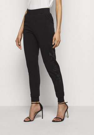 RHINESTONE LOGO PANTS - Tracksuit bottoms - black