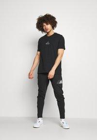 adidas Performance - BLUV SERE ESSENTIALS - Pantaloni sportivi - black - 1
