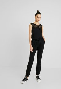 Urban Classics - LADIES BLOCK - Jumpsuit - black - 1