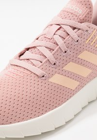 adidas Performance - CALIBRATE RESPONSE GO RUNNING SHOES - Neutral running shoes - pink spice/glow orange/glow pink