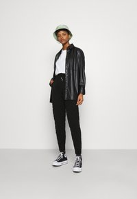 Topshop - QUILTED - Tracksuit bottoms - black - 1
