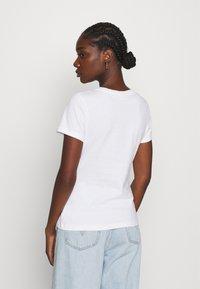 Calvin Klein - SLIM FIT 2 PACK - T-shirt z nadrukiem - black/bright white - 2