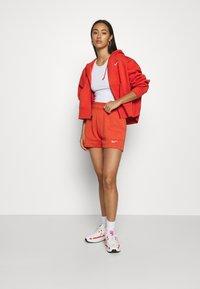 Nike Sportswear - TREND - Shorts - mantra orange/white - 1