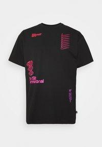 Nike SB - TEE INTERNATIONAL UNISEX - Camiseta estampada - black - 0